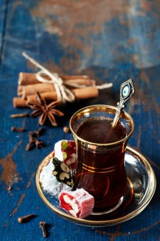 Turkish tea and delights on wooden background